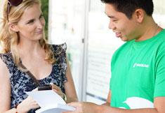 Passenger speaking with Customer Liaison Officer